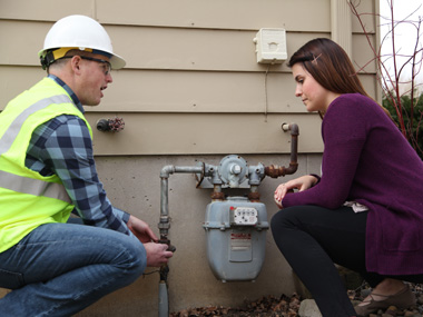 MEC Employee and Customer with Gas Meter