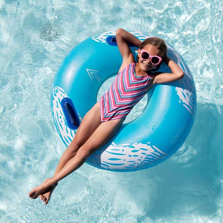Little girl floating in pool (mobile)