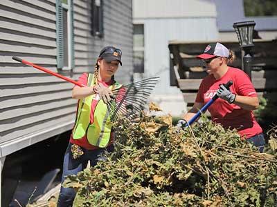 Employees clean up tree debris in Cedar Rapids post-Derecho 2020