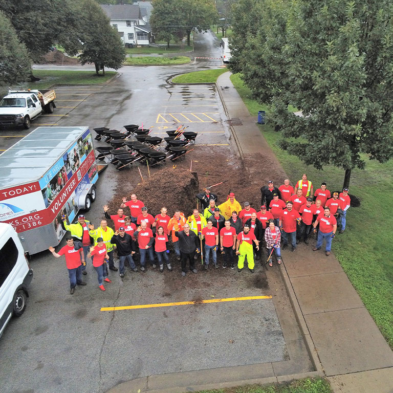 MidAmerican employees volunteer at a park clean up event