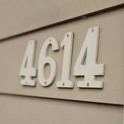 White house number 4614 mounted on siding