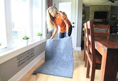 uncovering a rug from covering a air vent