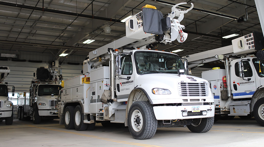 MidAmerican bucket trucks, prepared and waiting to be called into action before a storm