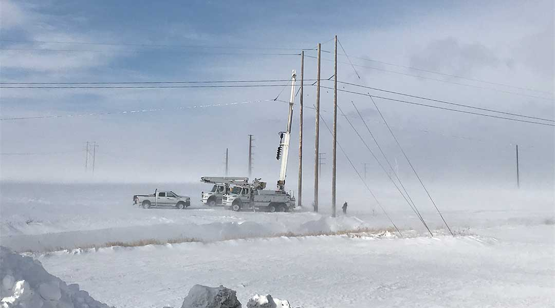 MidAmerican Employees fixing a substation lines in the middle of a snow storm