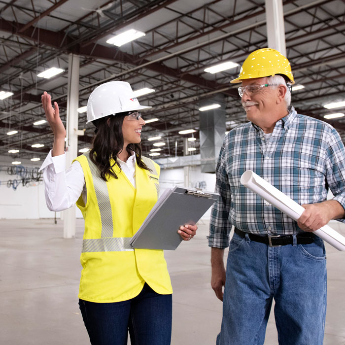 MEC worker with Contractor in Warehouse