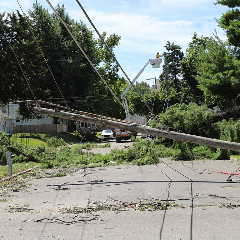 Downed pole, wires Davenport residential street - derecho 2020