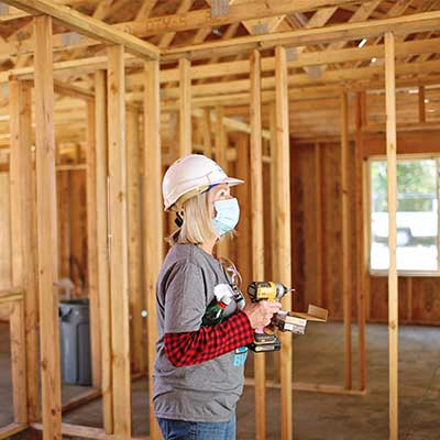 Women Volunteer building a house for Habitat for Humanity