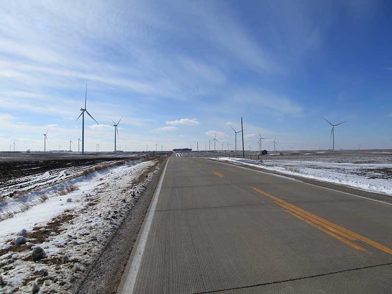 Road that cuts through a wind farm