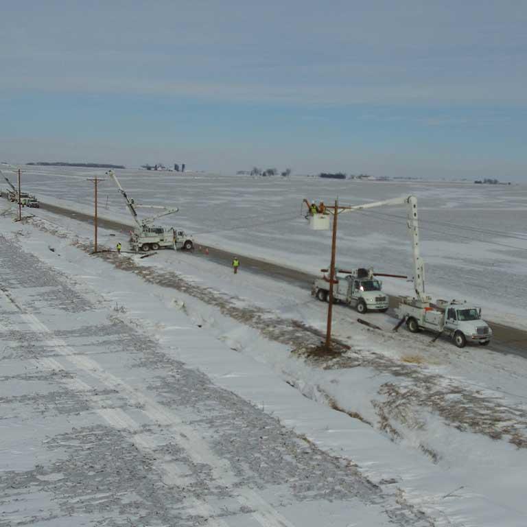 Lineman pole repair work, rural road