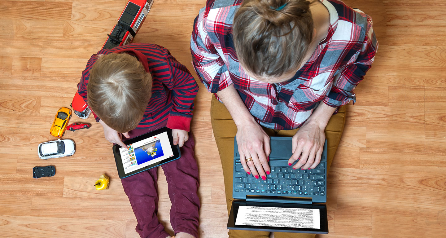Woman and child on electronic devices
